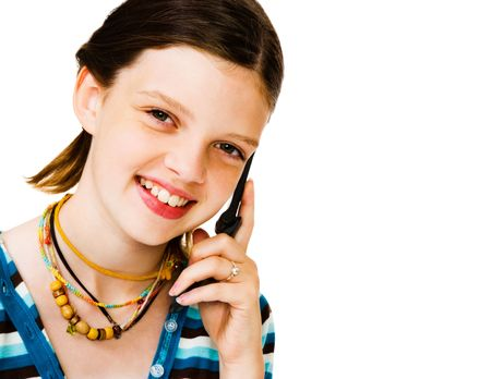 telecommunicating: Portrait of a girl talking on a mobile phone isolated over white Stock Photo