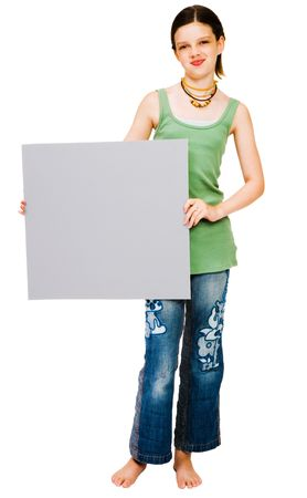 Smiling girl showing a placard isolated over white photo