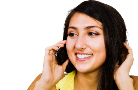 Confident woman talking on a mobile phone isolated over white Stock Photo - 5645783