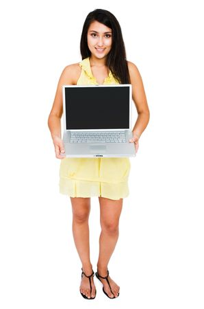 telecommunicating: Beautiful woman showing a laptop and posing isolated over white
