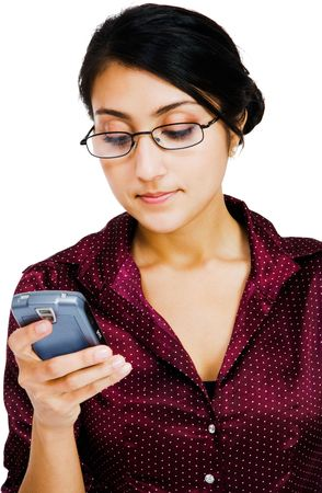 telecommunicating: Confident woman text messaging on a mobile phone isolated over white
