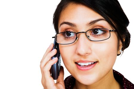 telecommunicating: Close-up of a woman talking on a mobile phone isolated over white Stock Photo