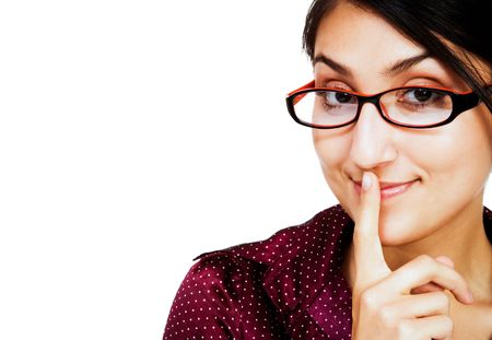 Woman posing with her finger on her mouth and smiling isolated over white