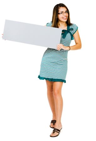 Happy woman showing a placard and posing isolated over white