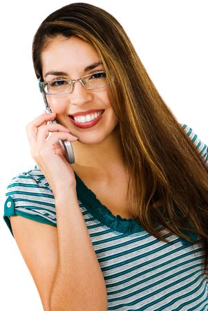 telecommunicating: Latin American woman talking on a mobile phone isolated over white