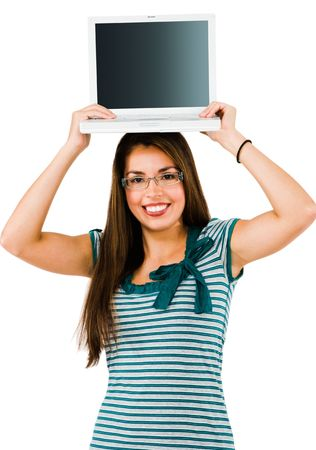 Smiling woman holding a laptop isolated over white