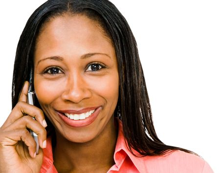 Smiling woman talking on a mobile phone isolated over white Stok Fotoğraf