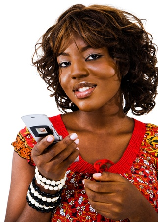 Young woman text messaging on a mobile phone isolated over white photo