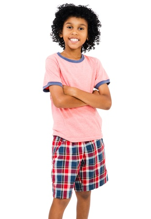 Child standing with her arms crossed isolated over white