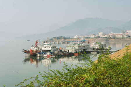 River passenger carriers at a pier of the city of Ichang photo