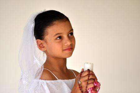 girl with candle looking up wearing white dress photo