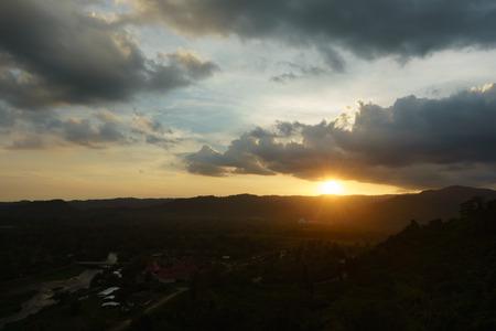 Beautiful mountains and sunset at Khun Dan Dam Prakarnchon Dam
