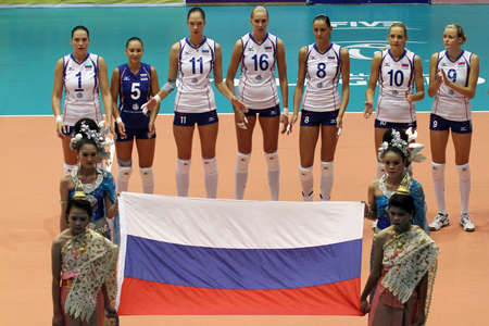 kick off: nakhon pathom,thailand, august 5, 2011 – world champions russia female volleyball team pay respectful attention to their flag and national anthem before kick off the first game for 2011 fivb world grand prix campaign with a victory 3-1sets over cuba