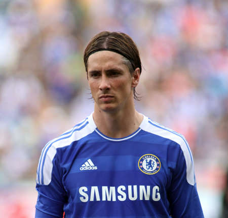 """premier league: Bangkok Thailand ,24 July 2011 : Fernando Torres , Chelsea FC' striker and Spain lines-up before a friendly match starting VS Thai Premier League All Star XI at the Rajamangala National Stadium with their Chelsea's """"Here to Play Here to Stay"""" 2011 Editorial"""