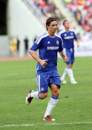 """Bangkok Thailand ,24 July 2011 : Fernando Torres , Chelsea FC' striker and Spain plays in a friendly match  VS Thai Premier League All Star XI at the Rajamangala National Stadium with their Chelsea's """"Here to Play Here to Stay"""" 2011campaign"""