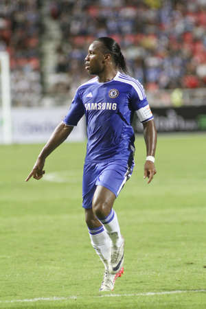 Bangkok Thailand ,24 July 2011 : Didier Drogba  , Chelsea FC' striker and Ivory Coast  plays a friendly match starting VS Thai Premier League All Star XI at the Rajamangala National Stadium with their Chelsea Asia Tour