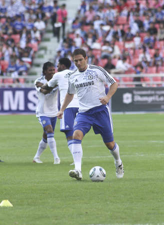Bangkok Thailand ,24 July 2011 :Frank Lampard , Chelsea FC's midfielder and England shows his talent in warm up session  before a friendly match starting VS Thai Premier League All Star XI at the Rajamangala National Stadium with Chelsea's 2011 Asia T Editorial