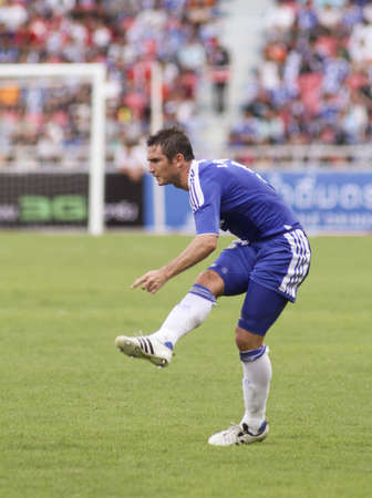 Bangkok Thailand ,24 July 2011 :Frank Lampard , Chelsea FC's midfielder and England shots a free kick in a friendly match  VS Thai Premier League All Star XI at the Rajamangala National Stadium with Chelsea's 2011 Asia Tour  Stock Photo - 10165805