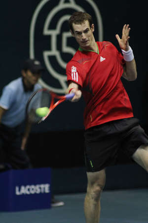 Bangkok , Thailand  30 Sepember 2011 : Andy Murray celebrates the winning  over Grigor Dimitov from Bulgaria ,2-0 sets (6-4 , 6-4) on the 2nd round  of 2011 PTT Thailand Open