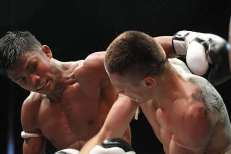 vitaly: BANGKOK,THAILAND-DECEMBER 16:Buakaw Por. Pramuk (Thailand ,left) in action with Vitaly Hurkou (Belarus,right) in the  Final round match of THAI FIGHT 2012,at King Chulalongkorn Monument Square, Bangkok,Thailand