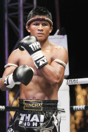 BANGKOK,THAILAND-DECEMBER 16:Buakaw Por. Pramuk (Thailand,) in action in the  Final round match of THAI FIGHT 2012,at King Chulalongkorn Monument Square, Bangkok,Thailand