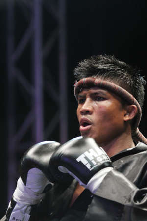 BANGKOK,THAILAND-DECEMBER 16:Buakaw Por. Pramuk (Thailand,) in action in the  Final round match of THAI FIGHT 2012,at King Chulalongkorn Monument Square, Bangkok,Thailand