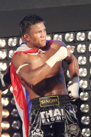 BANGKOK,THAILAND-DECEMBER 16:Buakaw Por. Pramuk from Thailand celebrate his winning in the  Final round match of  THAI FIGHT 2012,at King Chulalongkorn Monument Square, Bangkok,Thailand
