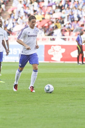striker: Bangkok Thailand ,24 July 2011 : Fernando Torres , Chelsea FC striker and Spain in warm up session before a friendly match starting VS Thai Premier League All Star XI at the Rajamangala National Stadium with their Chelsea 2011 Asia Tour