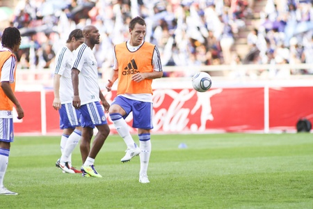 Bangkok Thailand ,24 July 2011 : : John Terry , Chelsea FCs captain and England in warm up session before a friendly match starting VS Thai Premier League All Star XI at the Rajamangala National Stadium with Chelseas 2011 Asia Tour Editorial