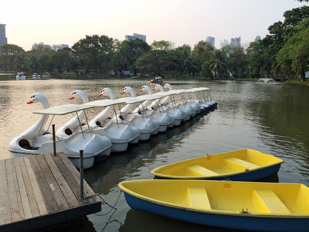 rowboats: Row of Swan Boats Style and Blue Yellow Rowboats used as Template Background Texture Stock Photo