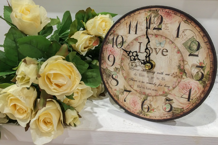 Old Classic Retro Clock with Bouquet of Roses