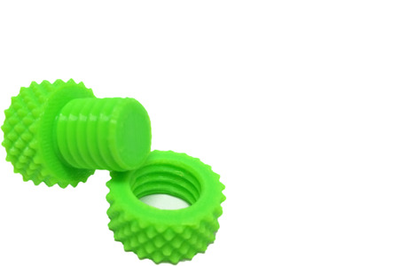 3d  bolt: Plastic Screw Nut and Bolt printed by 3D Printer on White Background at Corner with Space to input Text Stock Photo