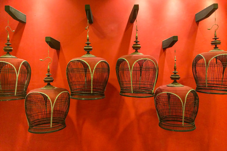 Group of Traditional Bird Cage on Red Background