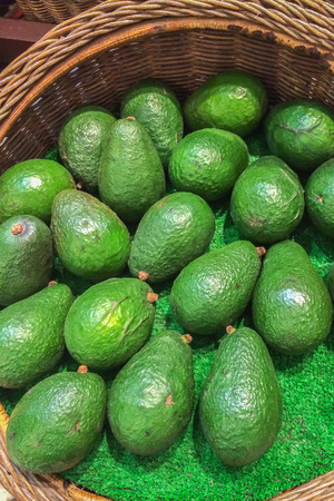 hass: Fresh Green Avocado in The Basket Background Texture Stock Photo