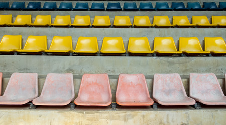 sequential: Grunge Old Multi Color Seat in The Stadium Background Texture Stock Photo