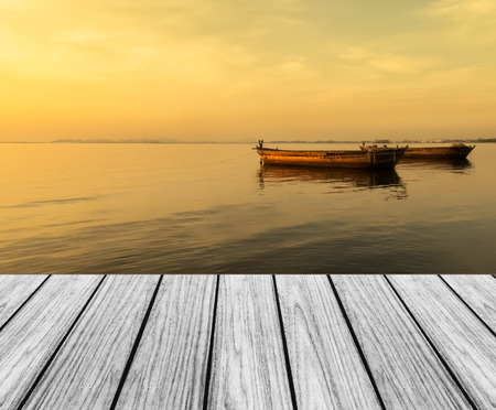 Wood Terrace on The Beach with Sunset and Big Boats Imagens
