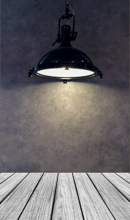 lamp shade: Empty Wooden Perspective Platform with Lamp Shade from Modern Black Metal Lamp Hanging on Gray Wall Background   with Copyspace used as Template to Mock up for Display Product