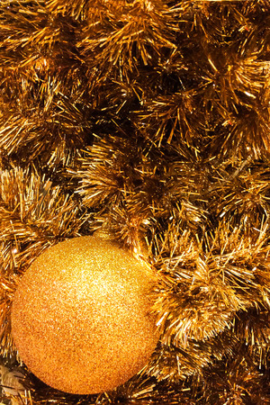 plastic christmas tree: Abstract Sparkling Gold Christmas Ball on Gold Christmas Tree Made from Plastic to Celebrate Merry Christmas and Happy New Year, Selective Focus