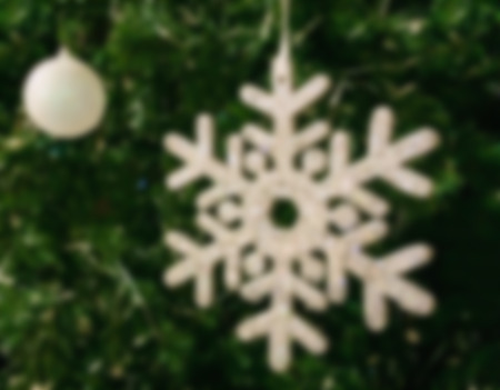 plastic christmas tree: Blur Abstract Sparkling White Snow Flake and Christmas Ball on Christmas Tree Made from Plastic to Celebrate Merry Christmas and Happy New Year used as Template to input Text