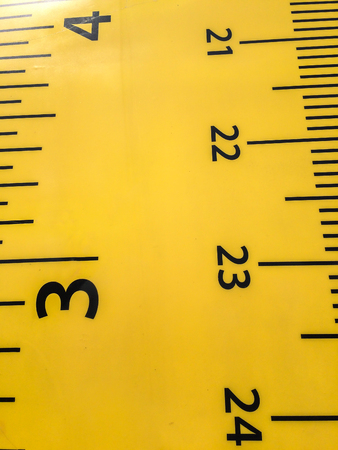 textured background: Close up of Plastic Yellow Ruler for Kids Background Texture