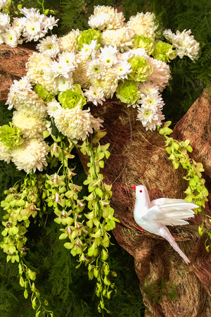 doublet: White Dove on Paper Tree with White Flowers, Orchid and Leaves for Decoration