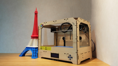 red white blue: Eiffel Tower Model with Red White Blue Stripe printed by 3D Printer with 3D Printer on Wooden Table