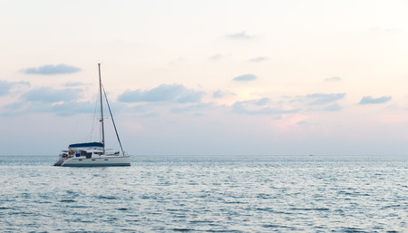dinghies: Single Yacht at The Corner in The Sea