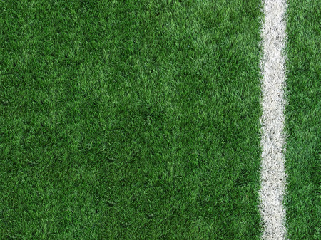 White Stripe Line at The Corner on Artificial Green Soccer Field as Copyspace to input Text from Top View used as Template