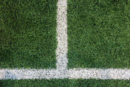 White Stripe Line on Artificial Green Soccer Field as Copyspace to input Text from Top View used as Template