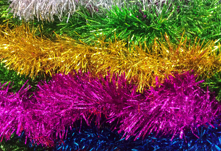 fasching: Abstract Various Colorful Shiny Serpentine Plastic Garland and Confetti as Ribbon for Holiday Party Decoration or Christmas and New Year Party Event used as Background or Template to input Text Stock Photo