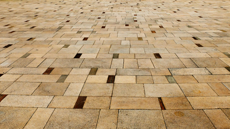 Perspective View of Light Brown Grunge Cracked Gray Brick Marble Stone on The Ground for Street Road. Sidewalk, Driveway, Pavers, Pavement in Vintage Design Flooring Square Pattern Texture Background