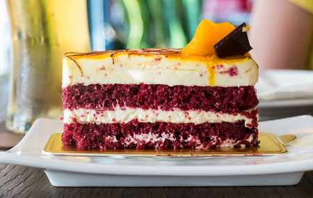 Layers of Red Velvet Cake with Cream Served on White Plate as Dessert