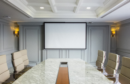 Conference Meeting Room with ceiling LED lights, Used Luxury Ergonomics Chairs, Table and TV set Interior Furniture. Business Meeting, Conference, Training Course, Lecture in The Elegant Design Office