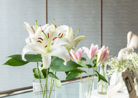 Bouquet of Big White Lilies in Glass Flowerpot at The Corner for Decoration in Wedding Ceremony